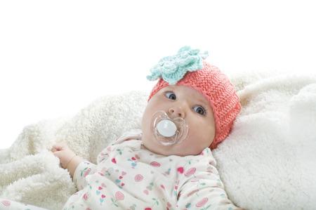 gir: Close-up portrait of pretty baby gir with dummyl, studio shot