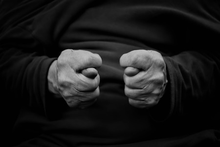 egoist: Double rude fig sign, closeup converted in black and white. Concept of body talk. Stock Photo