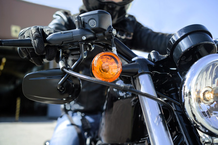 throttle: hand of a biker on a throttle control Stock Photo