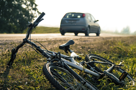 Car and bicycle accident, outdoor shot photo