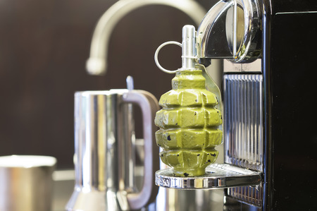 handgrenade: Hand-grenade on a coffee machine, concept of self defense, interior shot