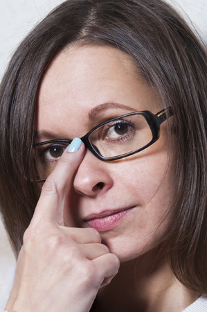 sort out: Vertical shot of a smart woman in glasses taking decision.