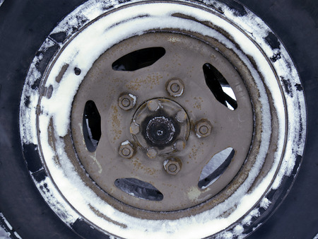 Close up of the wheel in snow, driving in a bad weather concept photo