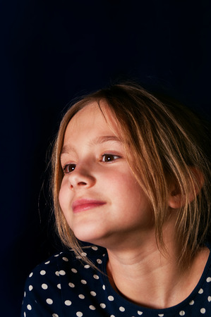 gaze: Vertical studio portrait of a dreamily looking girl with a distant gaze Stock Photo