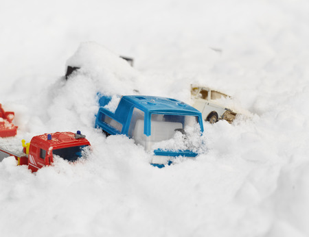Toy cars stuck in snowy conditions, outdoor  imitation of real accident photo