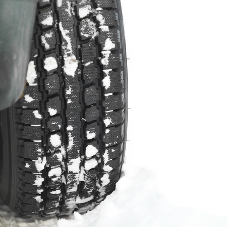 space weather tire: Car tire in the snow, close up particular isolated on white shot