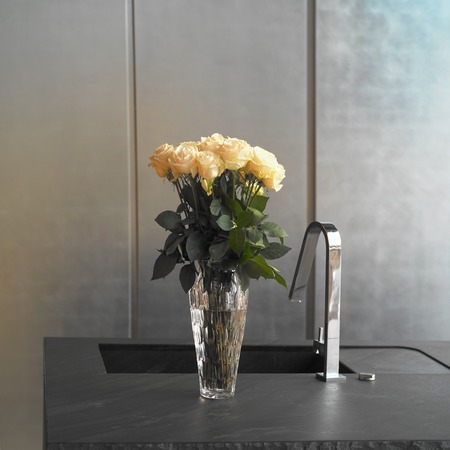 interior shot: Kitchen sink and vase with roses, square interior shot