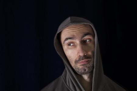 embarrassed: Portrait of a man looking embarrassed or religious, studio shot