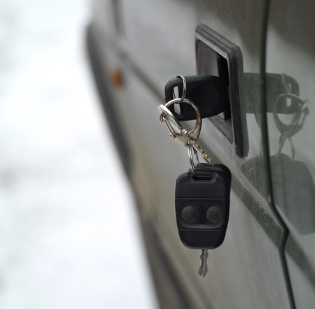 abandoned car: Abandoned car keys in a car door lock, concept of lost and found