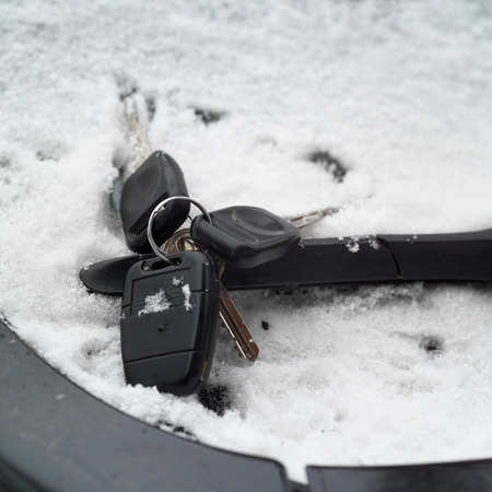 windscreen wiper: Forgotten ignition keys on a windscreen wiper, concept of driving in a bad weather conditions