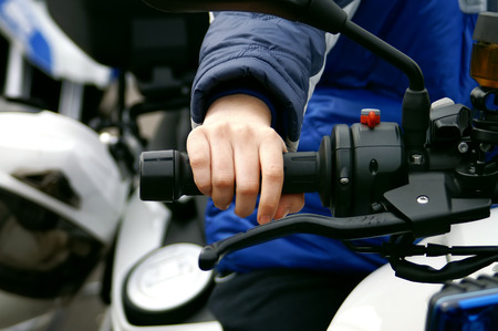 throttle: Hand of a child on a throttle control