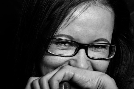 hilarious: Portrait of a hilarious brunette female laughing, closeup studio shot