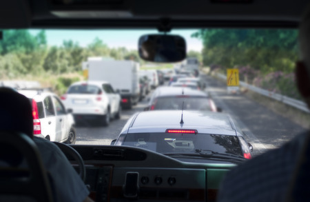 in particular: Driving minivan traffic jam ahead blurred shot with particular focus Stock Photo