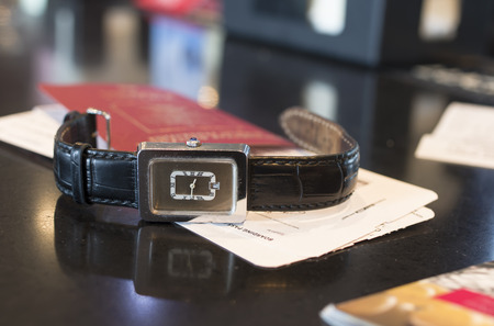 ides: Wrist watch in focus passport and boarding pass blurred concept of travel Stock Photo