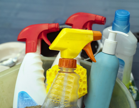 cleaning supplies: Closeup of colorful assorted cleaning supplies, outdoor shot with shallow depth of field Stock Photo