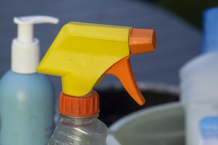 tidiness: Macro shot of yellow vaporizer and other cleaning supplies in the blurred background