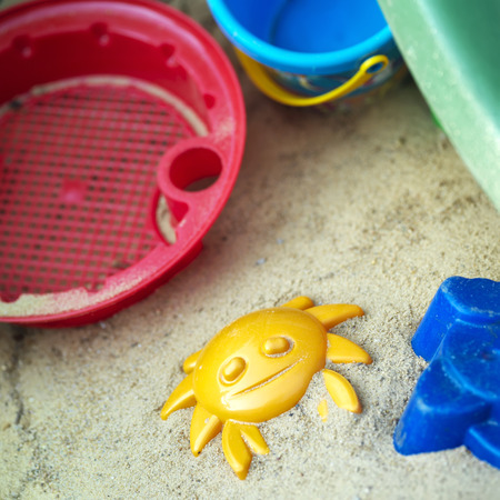 plastic toys: Plastic toys on the beach, overhead shot with selective focus