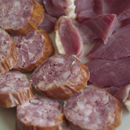 particular: Traditional home made salami laid on a plate, closeup shot with particular focus