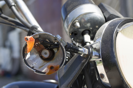 slivers: Crashed motorcycle turn indicator, closeup outdoor shot, concept of safety on the roads Stock Photo