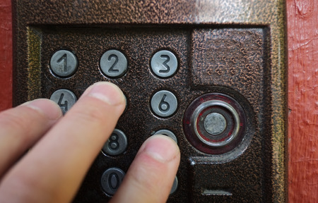 secret code: Hand entering secret code on a lock