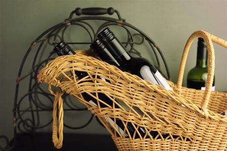 horizontal format: Still life of wine bottles in a basket, indoor shot, horizontal format