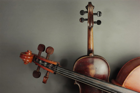 cropped shot: Still of the old violin and cello, studio cropped shot in horizontal format Stock Photo
