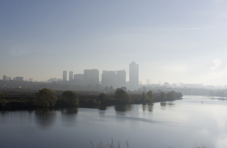 river scape: Silhouettes of a modern city scape behind the river