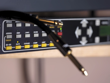 routing: Cables on studio recording unit, closeup with shallow depth of field