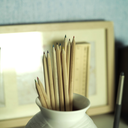 selective: Colored pencils in vase on the table, indoor shot with selective focus Stock Photo