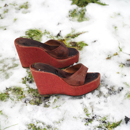 no heels: Red laddies high heels on a snow, outdoor square shot Stock Photo