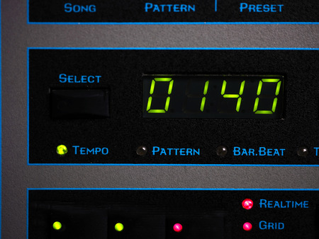 tempo: Screen of a synthesizer with song tempo, front macro shot with focus in image center