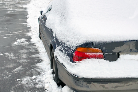 abandoned car: Abandoned car covered with snow, outdoor horizontal shot Stock Photo