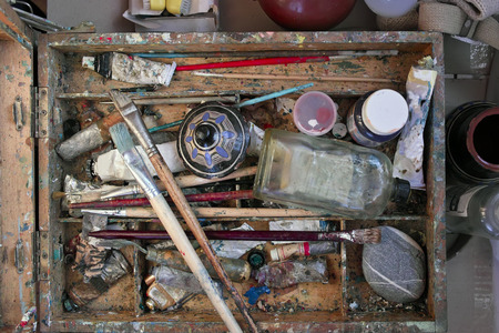 paintbox: Overhead shot of an artist paintbox with various artistic tools and colors Stock Photo