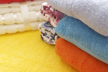 angled: Colorful bath towels stacked, cropped angled shot