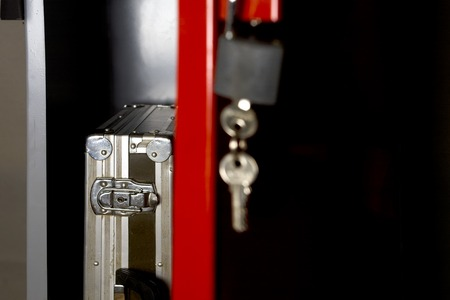 negligence: Open door of a metal safe with a briefcase, cropped studio shot, concept of safety or negligence Stock Photo