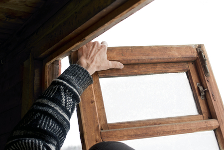 angled: Hand of a worker replacing the old wooden window, cropped angled shot Stock Photo