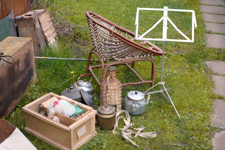 Various unwanted items spread out in a backyard, outdoor image