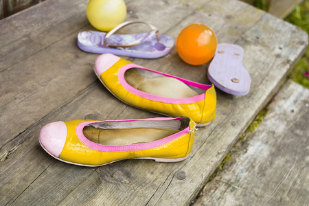 no entrance: Children shoes, sandals and colorful balls left on the wooden stairs, concept of summertime fun, selective focus Stock Photo
