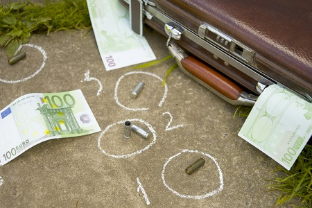 Crime scene with briefcase, cash,  chalk outlines on the asphalt. Outdoor closeup photo