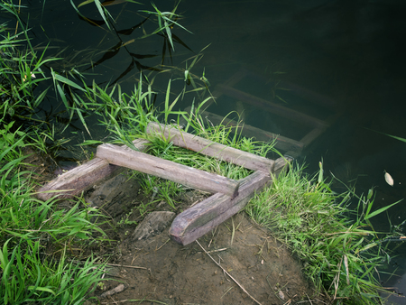 Filtrered image of a wooden ladder immersed into a water
