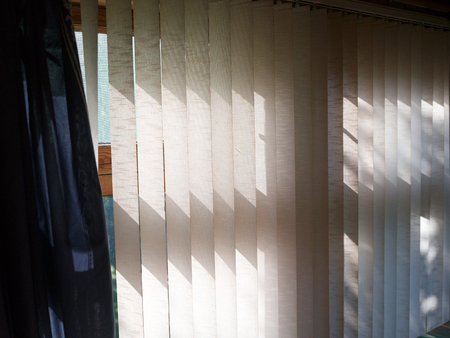 Vertical blinds half open on a window, interior cropped image 版權商用圖片 - 108168445