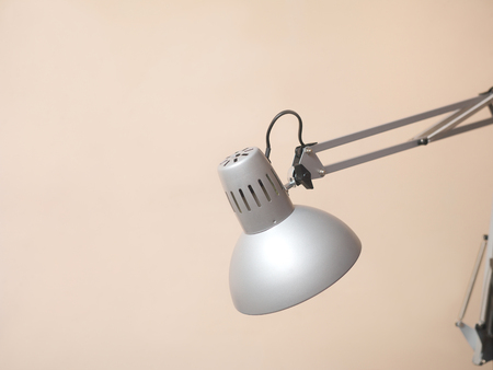 Close-up of expandable electric lamp against the wall Stock Photo