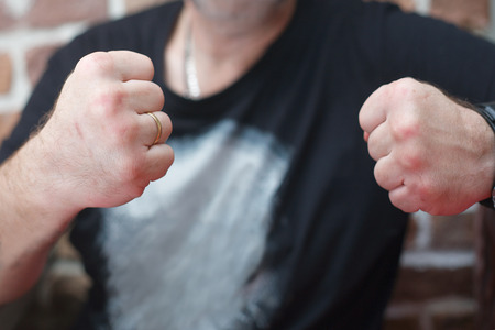 Cropped shot of a man with clenched fists, concept of aggression Stock Photo