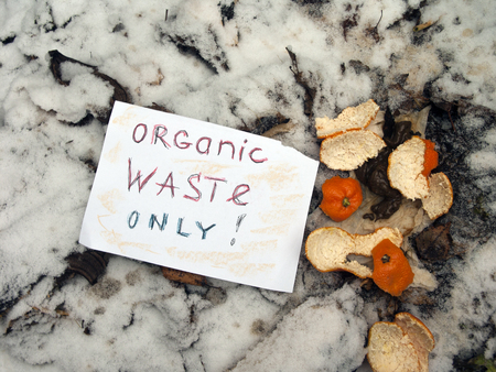 Organic waste only warning on a compost, outdoors close-up