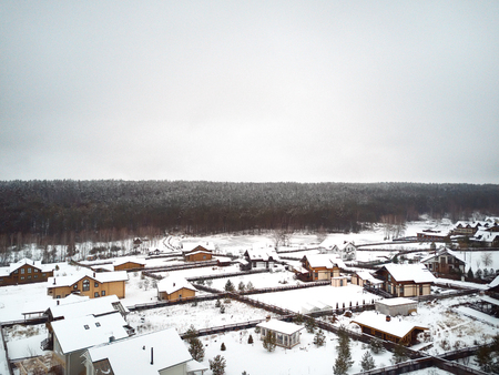 Aerial view of the houses and forest, winter scene Stock Photo