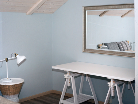 Lamp, table and mirror, modern interior after renovation Stock Photo