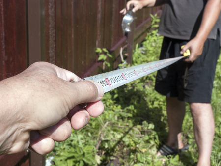 People with People with  tape measure, outdoor selective focus shot Stock Photo