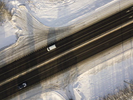 Aerial view of a traffic in winter, sunny day footage Stock Photo