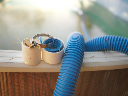 Swimming pool hose needs repair and hose clamp, outdoor close-up Stockfoto - 117836806