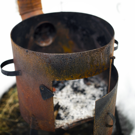 Old rusty outdoor stove with grunge metal surface, shallow depth of field shot Banco de Imagens
